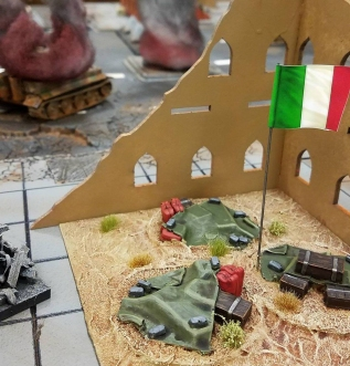 The Italian objective in blasted ruins.